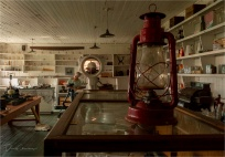 Two Photographers in the General Store - Derek Chambers