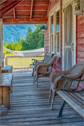 Who likes to sit on a porch? ©Gloria Melnychuk ~ at Tallheo Cannery, Bella Coola ~ 0694-491