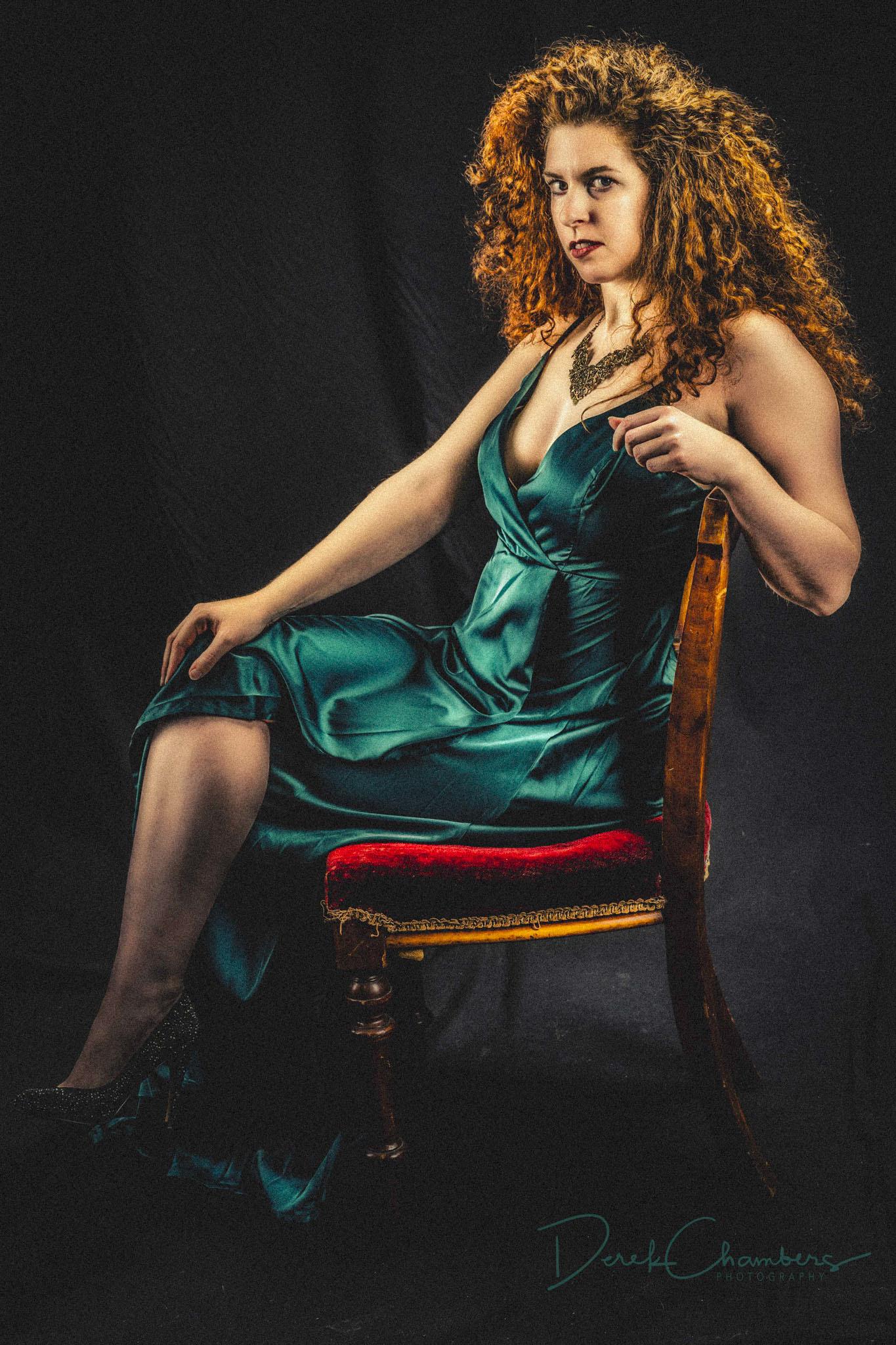 K35-S3308 - Hard Nosed Woman in a Green Dress - Derek Chambers